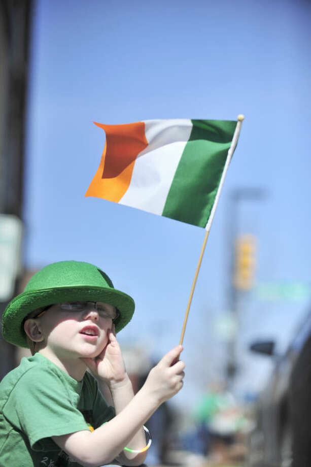 Colin Major, 5, waves the Irish flag during the St. Patrick's Day Parade through downtown Saturday, March 16, 2013 in Huntsville, Ala. The 36th Annual Ellen McAnelly Memorial St. Patrick's Day Parade was the largest St. Patrick's Day on record. (AP Photo/Eric Schultz, AL.com)