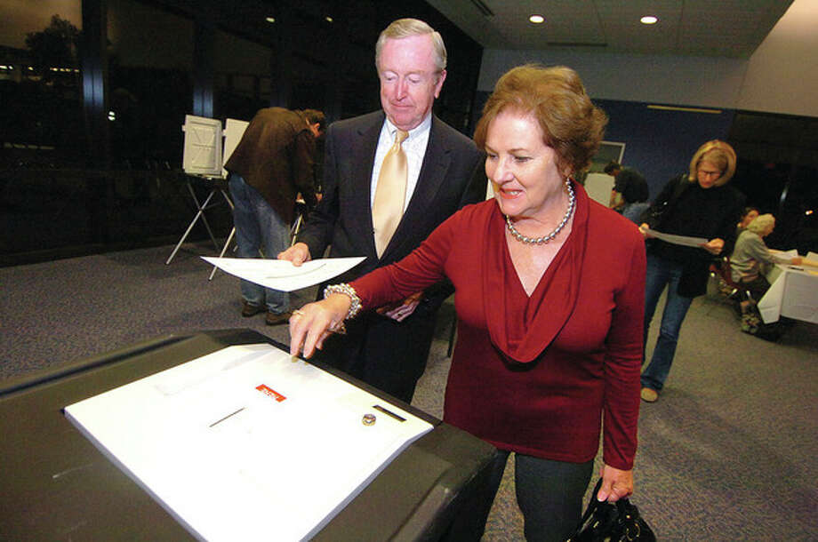 Wilton First Selectman Bill Brennan and his wife Kathleen cast their ballots Tuesday at the District 1 polling center at Wilton High School. Photo by Alex von Kleydorff / 2011 The Hour Newspapers