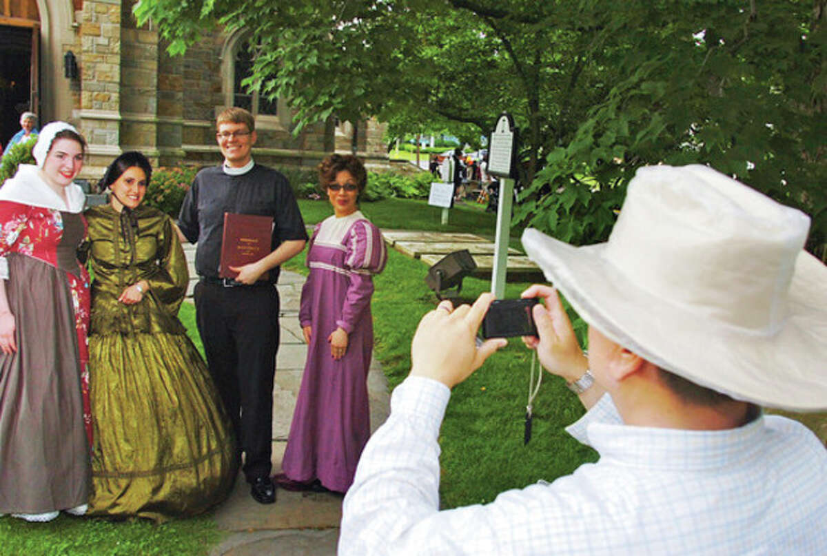 Reenactors pose for a photo during St. Paul's 275th anniversary celebration Saturday. Hour photo / Erik Trautmann