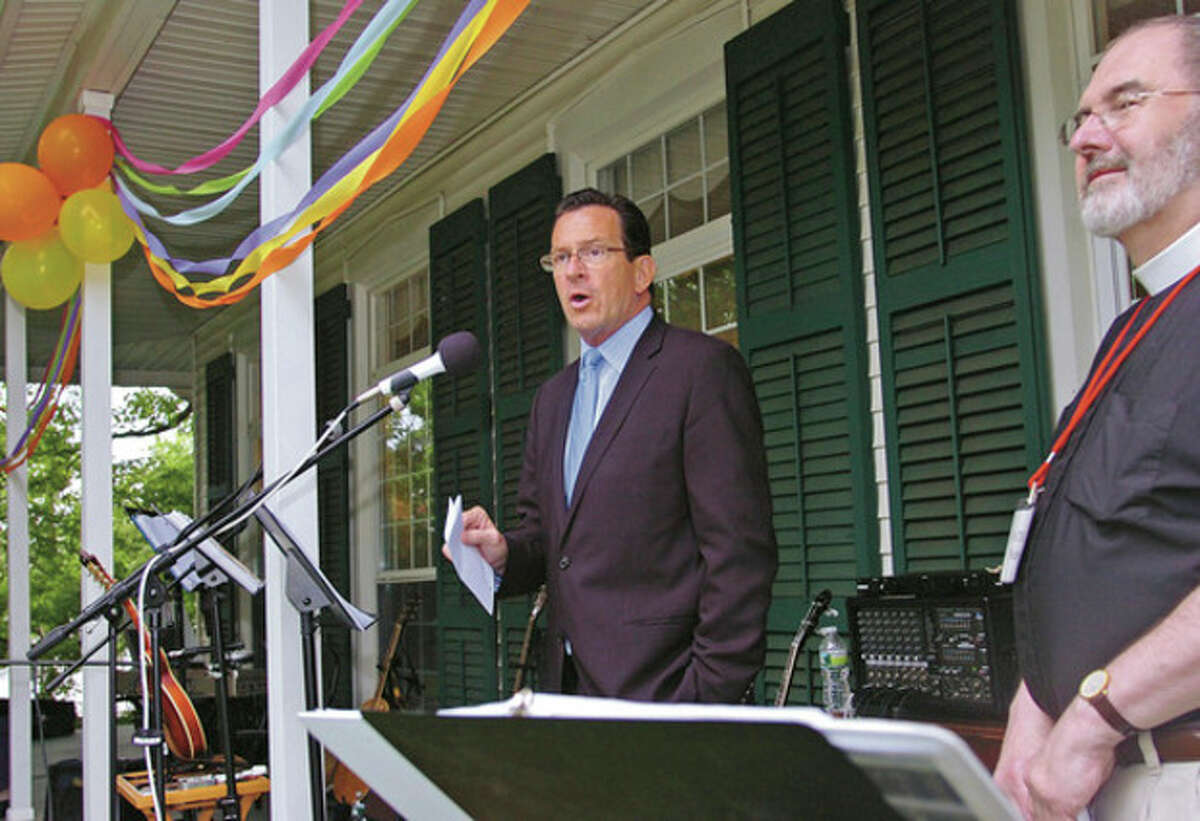 Governor Dannell Malloy flanked by Father Nichaols Lang addressed the small crowd gathered for St. Paul's 275th anniversary celebration Saturday. Hour photo / Erik Trautmann