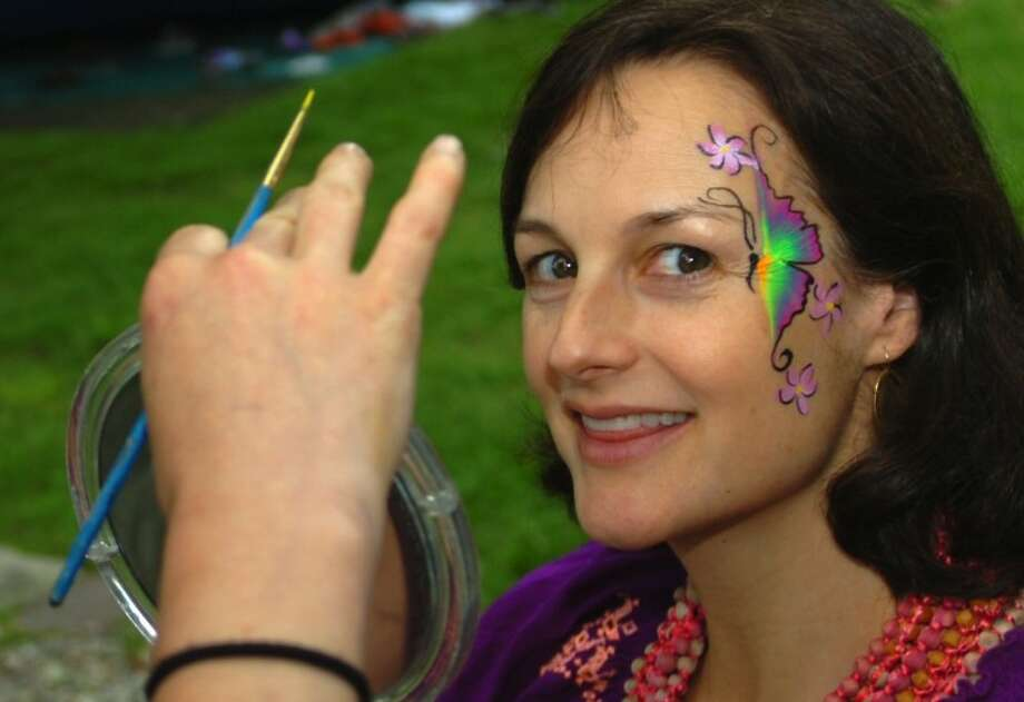 Carey Hahn gets her face painted at the St. Paul's 275th anniversary celebration Saturday. Hour photo / Erik Trautmann