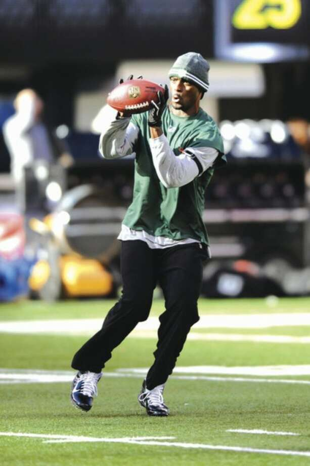 AP photo New York Jets' Plaxico Burress catches a ball before a recent game. The receiver says Michael Vick's success helped in his return to the NFL.