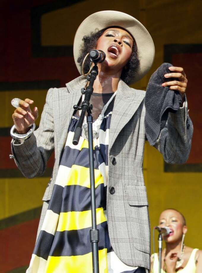 FILE - In this May 7, 2011 file photo, Lauryn Hill performs at the New Orleans Jazz and Heritage Festival in New Orleans. Federal prosecutors have charged five-time Grammy winner Lauryn Hill with willfully failing to file income tax returns with the IRS. Authorities say Hill earned more than $1.6 million during the three years that she failed to file returns. Prosecutors say her primary source of income is royalties from the recording and film industries. The 37-year-old South Orange, N.J., resident is scheduled to appear before a federal magistrate on June 29. (AP Photo/Patrick Semansky, file)