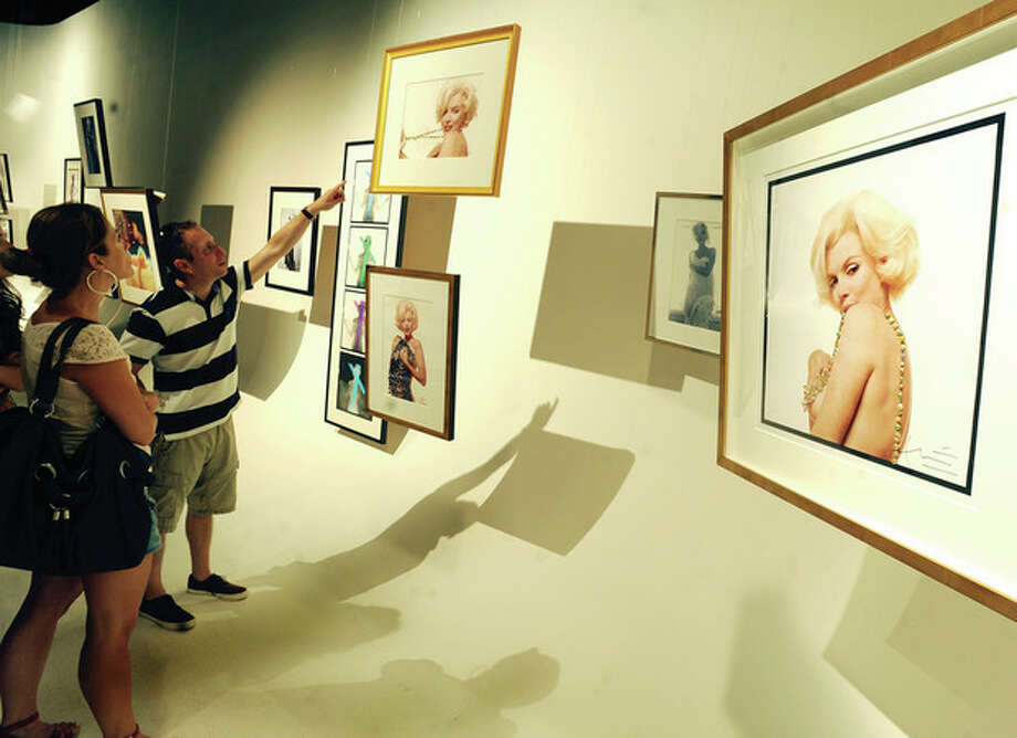 Hour photo/Matthew VinciMarilyn Monroe photographs by Bert Stern on display at SONO Studios in Norwalk on Sunday.