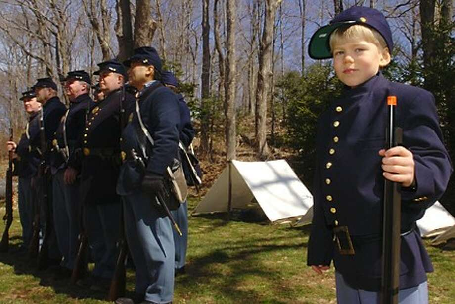 7 year old Tristan Fraise drills with the Civil War reeactors at the encampment at the Wilton Historical Society Saturday as part of the Society''s Civil War Series of lectures. Hour photo / Erik Trautmann