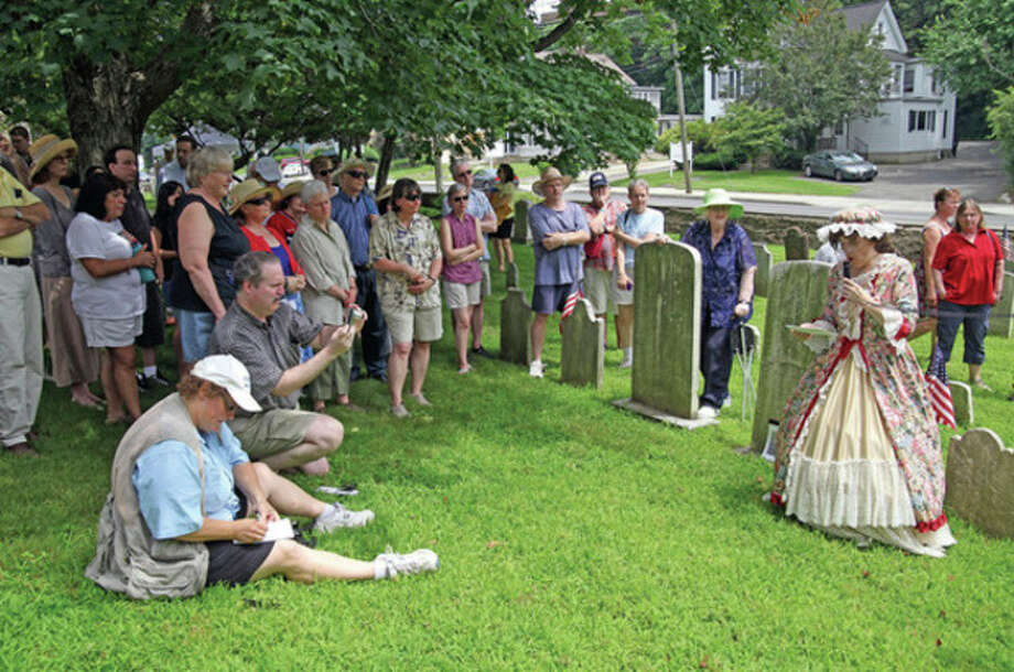 Hour Photos / Danielle Robinson Madeleine Eckert gives a cemetery tour held by the Norwalk Historical Society at St. PaulÕs on the Green Monday afternoon.