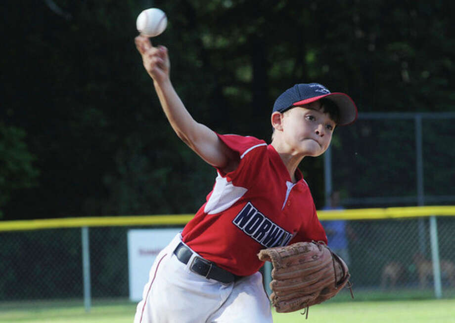 Hour photo/Matthew Vinci Norwalk Little League pitcher Shane Popkins delivers a pitch during WednesdayÕs Corbo tournament game against Cranbury. Little League posted a 5-2 victory in the contest.