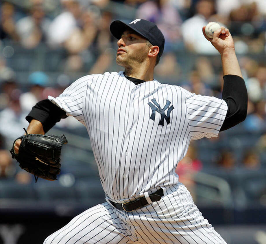 New York Yankees starting pitcher Andy Pettitte delivers in the first inning against the New York Mets during their baseball game at Yankee Stadium in New York, Sunday, June 10, 2012. (AP Photo/Kathy Willens) / AP