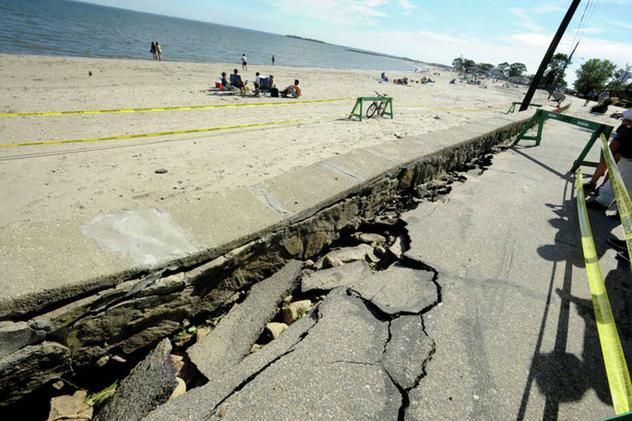 Storm damage along the sidewalk at Compo Beach in Westport. hour photo/matthew vinci / (C)2011, The Hour Newspapers, all rights reserved
