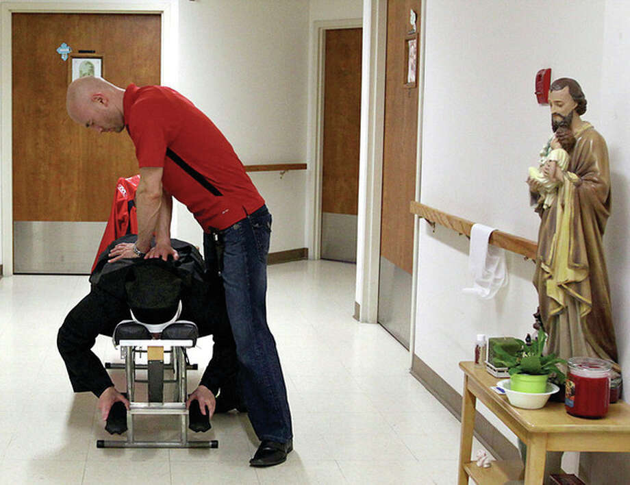 AP photos / Journal Inquirer, Jared RamsdellIn these March 7 photos, above, Mother Superior Marie Julie Saegaert, a nun with the Sisters of Charity of Our Lady Mother of the Church, receives a chiropractic adjustment from Dr. Vasco Valov of ProHealth Chiropractic at the Motherhouse in Baltic, Conn. Below, Sister Monica Mary Kvasnik, also with the Sisters of Charity of Our Lady Mother of the Church, receives a chiropractic adjustment from Dr. Jason Sousa of ProHealth Chiropractic at the Motherhouse. / Journal Inquirer