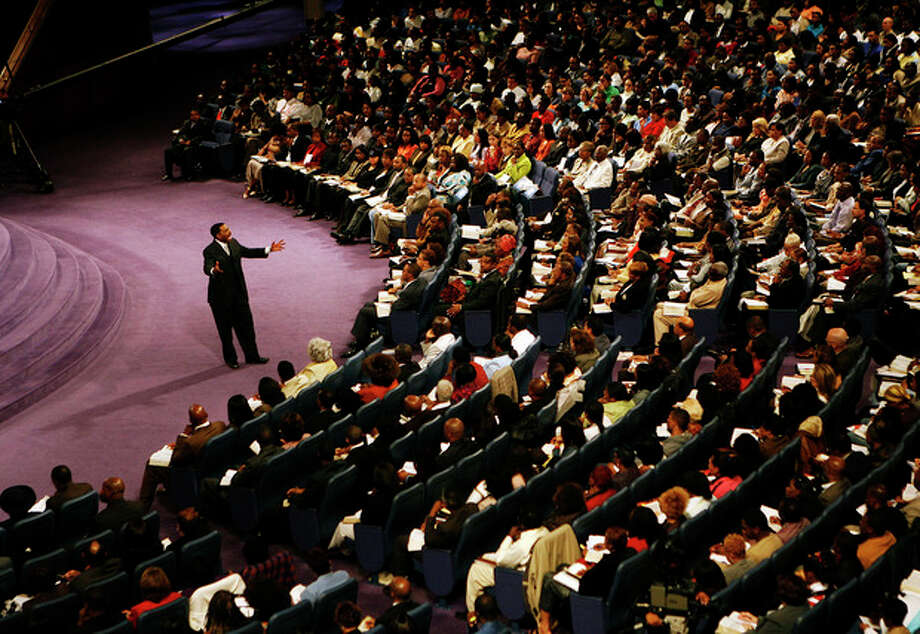 "In this Sunday, Nov. 11, 2007 photo, Rev. Creflo Dollar delivers his second sermon of the day at World Changers Church International, in College Park, Ga. Dollar has been arrested after authorities say he slightly hurt his 15-year-old daughter in a fight at his metro Atlanta home. Fayette County Sheriff's Office investigator Brent Rowan says deputies responded to a call of domestic violence at the home around 1 a.m. Friday, June 8, 2012. Rowan says the 50-year-old pastor and his daughter were arguing over whether she could go to a party when Dollar ""got physical"" with her, leaving her with ""superficial injuries."" (AP Photo/Atlanta Journal-Constitution, Pouya Dianat) MARIETTA DAILY OUT; GWINNETT DAILY POST OUT; LOCAL TV OUT; WXIA-TV OUT; WGCL-TV OUT / Atlanta Journal-Constitution"
