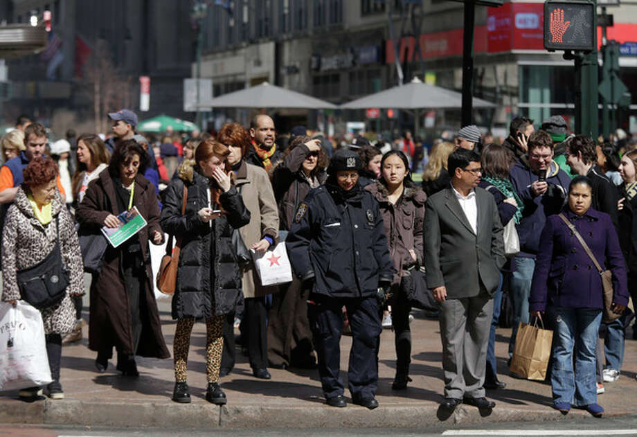 In this photo taken March 13, 2013, pedestrians wait to cross a New York street. An historic decline in the number of U.S. whites and the fast growth of Latinos are blurring traditional black-white color lines in the U.S. The demographic shift is now a potent backdrop to an immigration overhaul bill, being debated in Congress, that could offer a path to citizenship for 11 million mostly Hispanic illegal immigrants. (AP Photo/Seth Wenig) / AP