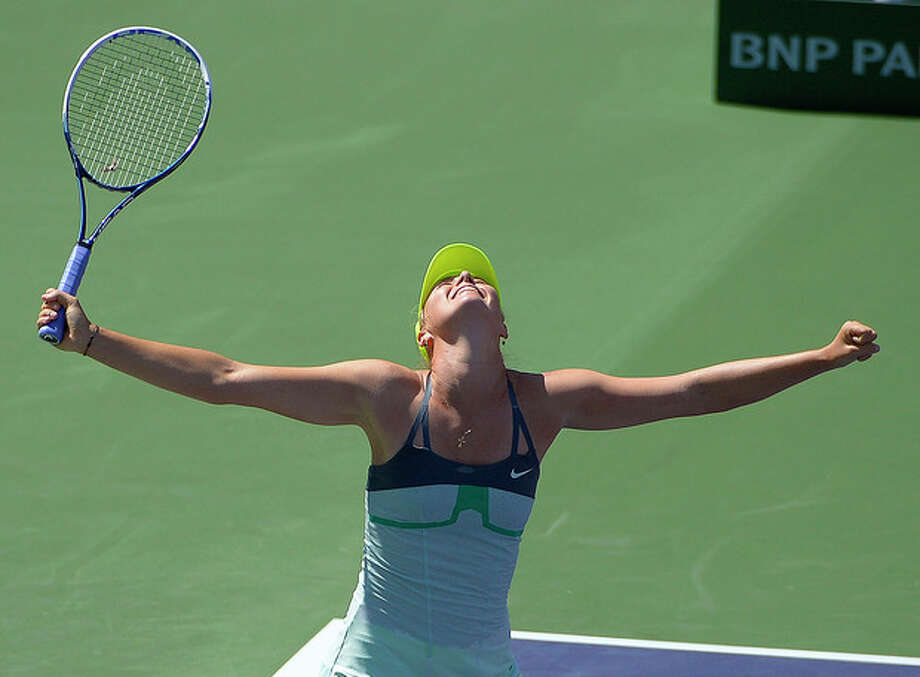 Maria Sharapova, of Russia, celebrates her win over Caroline Wozniacki, of Denmark, in their match at the BNP Paribas Open tennis tournament on Sunday, March 17, 2013, in Indian Wells, Calif. Sharapova won 6-2, 6-2. (AP Photo/Mark J. Terrill) / AP