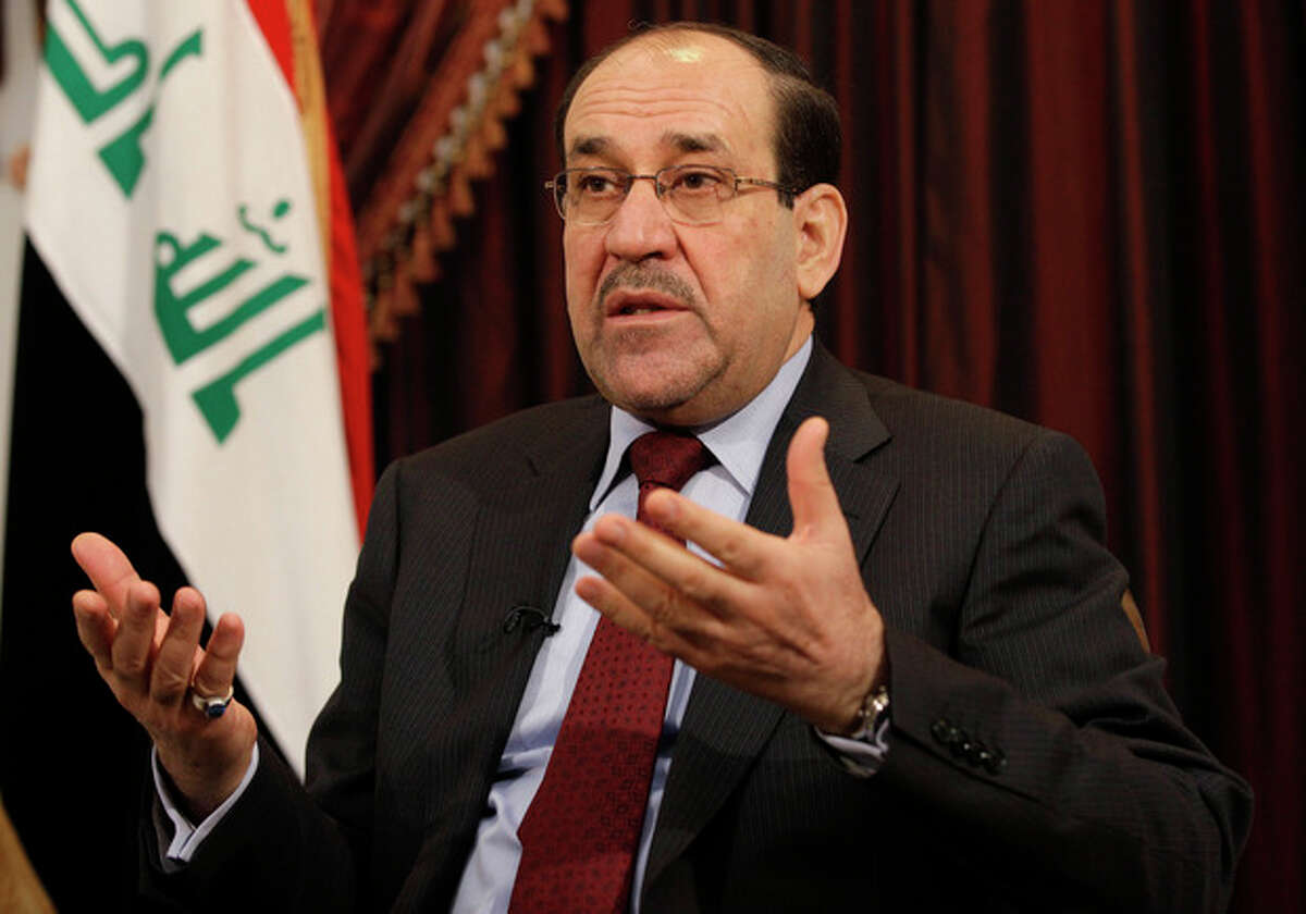 FILE - In this Dec. 3, 2011 file photo, Iraq's Prime Minister Nouri al-Maliki speaks during an interview with The Associated Press in Baghdad. Opponents of Al-Maliki have failed to muster enough support to bring him down in a vote of no confidence, Iraq's president said in a statement posted on his website Sunday, June 10, 2012. (AP Photo/Hadi Mizban, File)