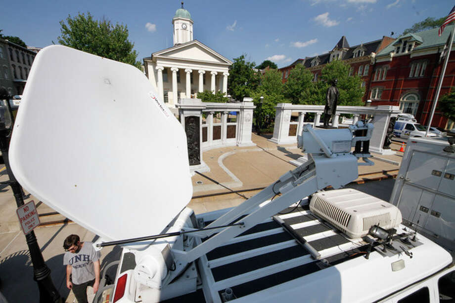 Television satellite trucks line South Allegheny Street in front of the Centre County Courthouse in Bellefonte, Pa., Sunday, June 10, 2012, in preparation for opening statements in the child sexual abuse trial of former Penn State Football assistant football coach Jerry Sandusky on Monday morning. (AP Photo/Gene J. Puskar) / AP