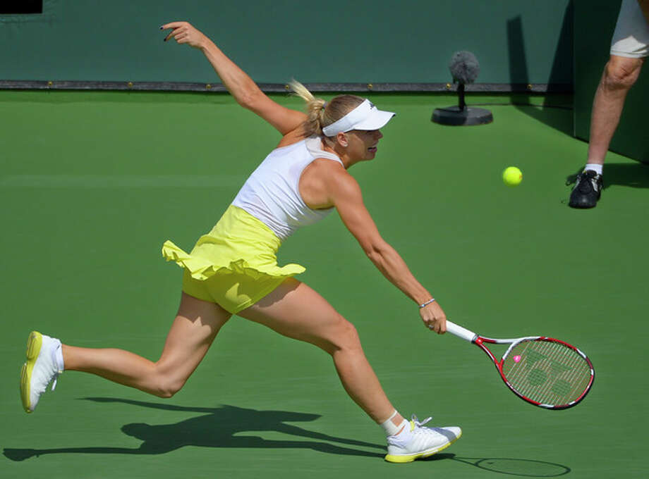Caroline Wozniacki, of Denmark, reaches for a return against Maria Sharapova, of Russia, during their match at the BNP Paribas Open tennis tournament on Sunday, March 17, 2013, in Indian Wells, Calif. (AP Photo/Mark J. Terrill) / AP