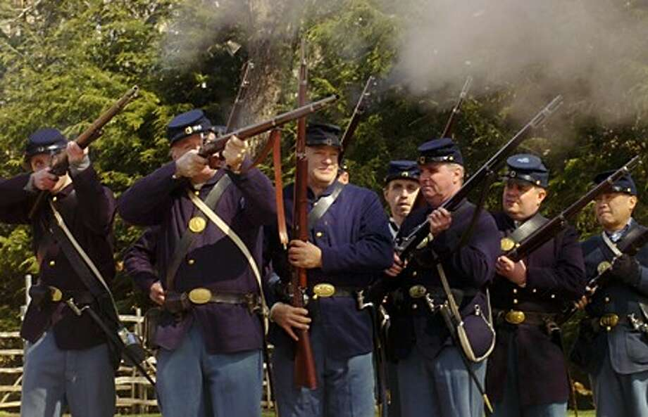 Civil War reeactors of the 14th CT Volunteer Regiment fire off a volley at the encampment at the Wilton Historical Society Saturday as part of the Society''s Civil War Series of lectures. Hour photo / Erik Trautmann
