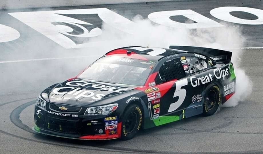 NASCAR Sprint Cup Series driver Kasey Kahne (5) does a burnout after winning the Food City 500 auto race, Sunday, March 17, 2013, in Bristol, Tenn. (AP Photo/Wade Payne) / FR23601 AP
