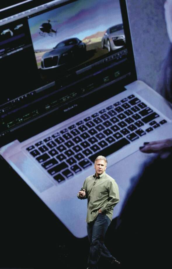 "Phil Schiller, Apple's senior vice president of worldwide marketing, talks about new features to the company's laptops during the Apple Developers Conference in San Francisco, Monday, June 11, 2012. Apple says it's introducing a laptop with a super-high resolution ""Retina"" display, setting a new standard for screen sharpness. (AP Photo/Marcio Jose Sanchez)"