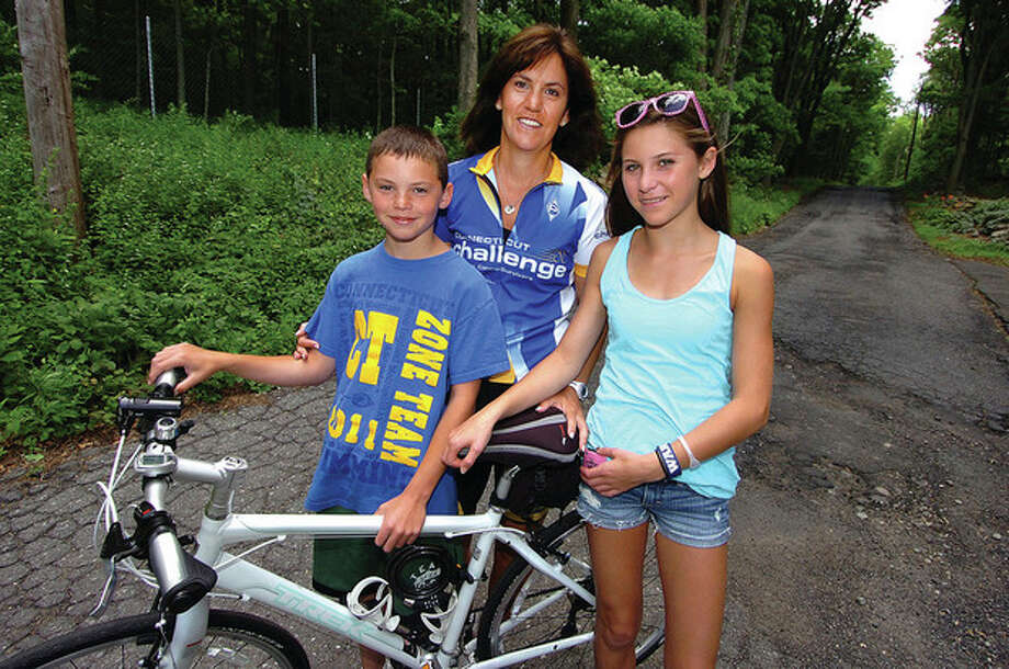 Hour Photo/Alex von Kleydorff. ? Jenn Lewis of Wilton with 10-year-old son, Jack, and 14-year-old Julia, as she prepares for the CT Challenge. / 2011 The Hour Newspapers