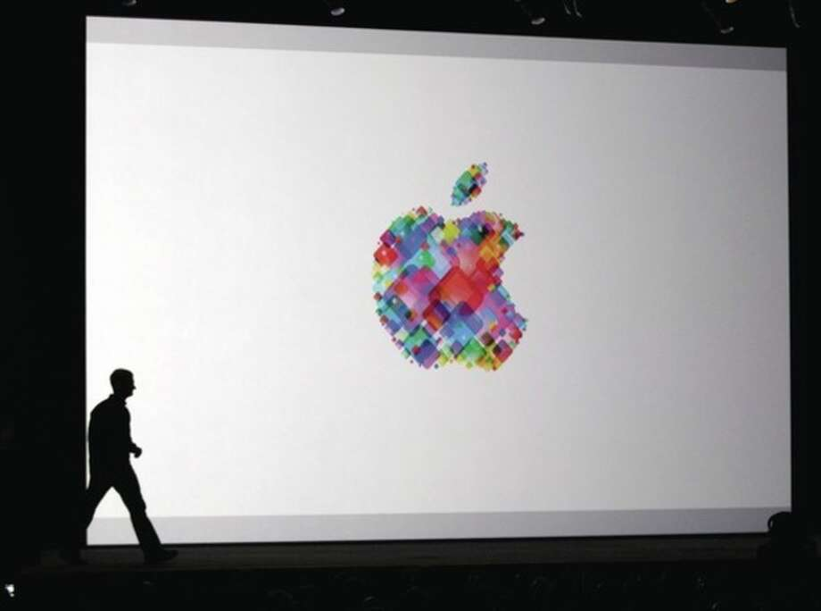 "Apple CEO Tim Cook enters the stage during the Apple Developers Conference in San Francisco, Monday, June 11, 2012. Apple says it's introducing a laptop with a super-high resolution ""Retina"" display, setting a new standard for screen sharpness. The new MacBook Pro will have a 15-inch screen and four times the resolution of previous models, Apple CEO Tim Cook told developers at a conference in San Francisco. (AP Photo/Marcio Jose Sanchez) / AP"