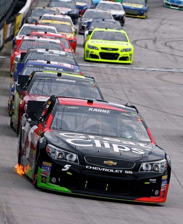 Kasey Kahne (5) leads the field during the NASCAR Sprint Cup Series Food City 500 auto race on Sunday, March 17, 2013, in Bristol, Tenn. (AP Photo/Wade Payne) / FR23601 AP