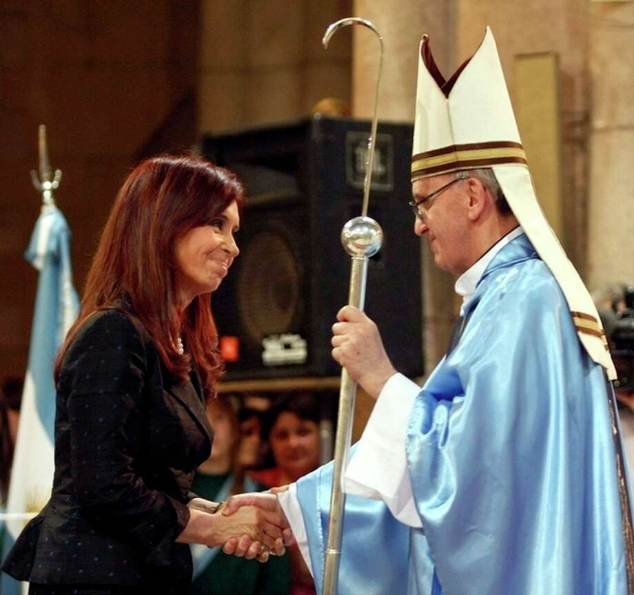 FILE - In this Dec. 12, 2008 file photo, Argentina's President Cristina Fernandez, left, shakes hands with Buenos Aires' archbishop Jorge Mario Bergoglio in Lujan, Argentina. Bergoglio, who chose the name of Francis, was chosen as the 266th pontiff of the Roman Catholic Church on March 13, 2013. Pope Francis has honed his leadership skills in one of the most difficult classrooms on the planet: Argentina, where politics has long been a blood sport practiced only by the brave. (AP Photo/DyN, File) / DYN