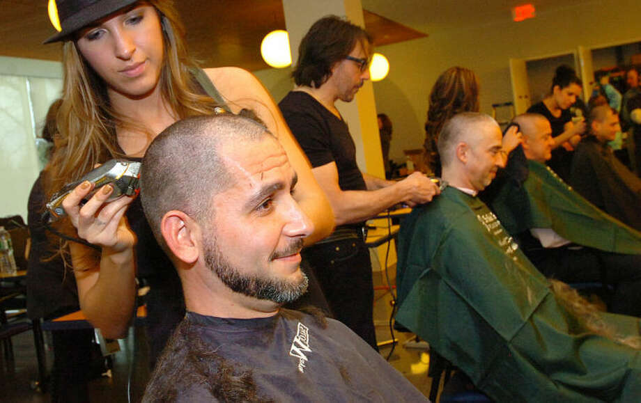 Hour Photo/Alex von Kleydorff. Consultant Jason Thonpson raised almost $9000 to have his head shaved at Gen Re St. Baldricks in Stamford.