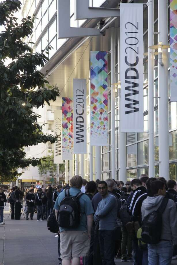 A line of attendees wait to get inside for the keynote at the Apple Developers Conference in San Francisco, Monday, June 11, 2012. Apple CEO Tim Cook is expected to show off new iPhone software and updated Mac computers and provide more details on future releases of Mac software when he kicks off the company's annual conference Monday. (AP Photo/Paul Sakuma)