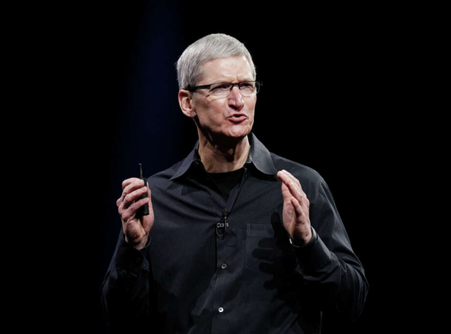 "Apple CEO Tim Cook speaks at the Apple Developers Conference in San Francisco, Monday, June 11, 2012. Apple says it's introducing a laptop with a super-high resolution ""Retina"" display, setting a new standard for screen sharpness.The new MacBook Pro will have a 15-inch screen and four times the resolution of previous models, Cook told developers at a conference in San Francisco. (AP Photo/Paul Sakuma) / AP"