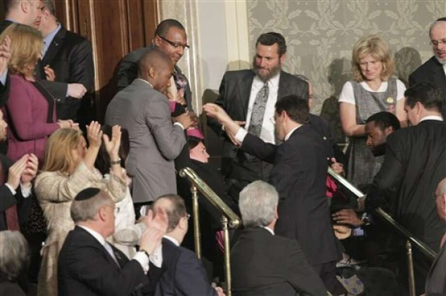 A protester is dragged from the House Chamber on Capitol Hill in Washington, Tuesday, May 24, 2011, as Israel''s Prime Minister Benjamin Netanyahu addressed a joint meeting of Congress. (AP Photo/J. Scott Applewhite)