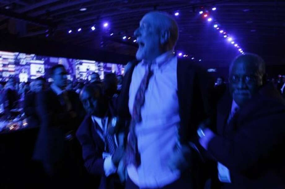 A man is escorted out by security as he shouts in protest against Israeli Prime Minister Benjamin Netanyahu, who was speaking at the American Israel Public Affairs Committee (AIPAC) Gala Banquet in Washington on Monday, May 23, 2011. (AP Photo/Jose Luis Magana)