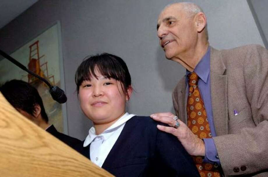 Dr. William Jassey, consultant to the Board of Education''s Japanese exchange program in Norwalk introduces Kotone Veki 15, who spoke to families and teachers on Tuesday night at City Hall /hour photo matthew vinci