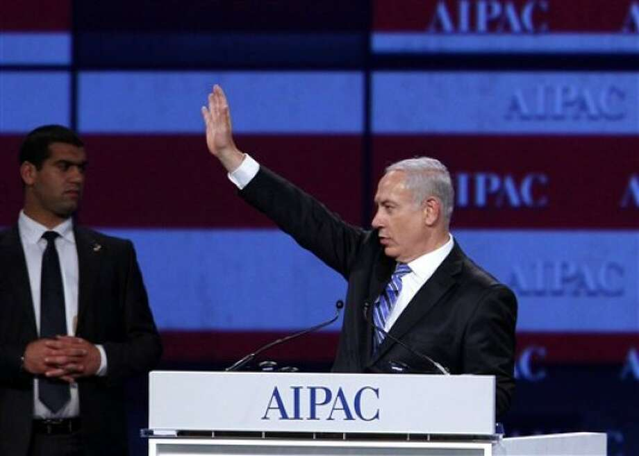 Israel Prime Minister Benjamin Netanyahu waves to the crowd at the American Israel Public Affairs Committee meeting in Washington, on Monday, May 23, 2011. (AP Photo/Jose Luis Magana)