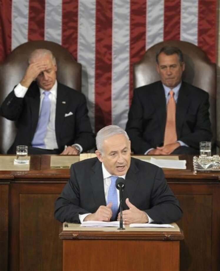 Israel''s Prime Minister Benjamin Netanyahu gestures while addresses a joint meeting of Congress on Capitol Hill in Washington, Tuesday, May 24, 2011. House Speaker House John Boehner of Ohio, right, and Vice President Joe Biden listen behind. (AP Photo/Susan Walsh)