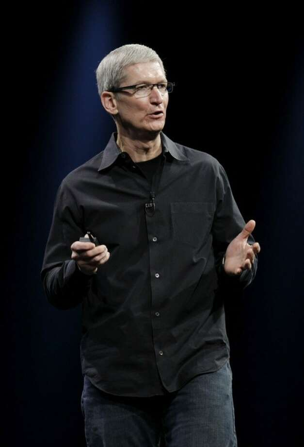 Apple CEO Tim Cook speaks at the Apple Developers Conference in San Francisco, Monday, June 11, 2012. Cook kicked off the company's annual conference for software developers on Monday. He is expected to show off new iPhone software and updated Mac computers and provide more details on future releases of Mac software. (AP Photo/Paul Sakuma)