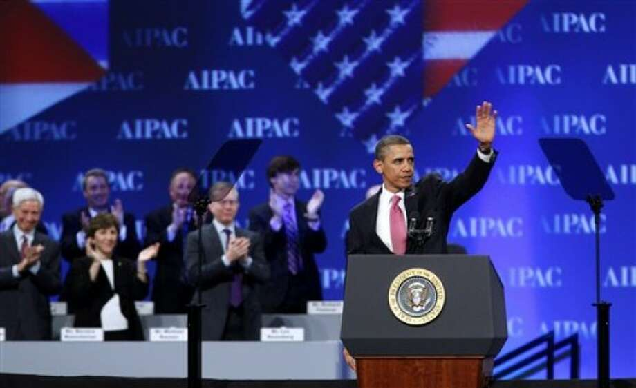 President Barack Obama waves after speaking at the American Israel Public Affairs Committee (AIPAC) convention in Washington Sunday, May 22, 2011. Obama said the bonds between the U.S. and Israel are unbreakable. (AP Photo/Jose Luis Magana)(AP Photo/Jose Luis Magana)