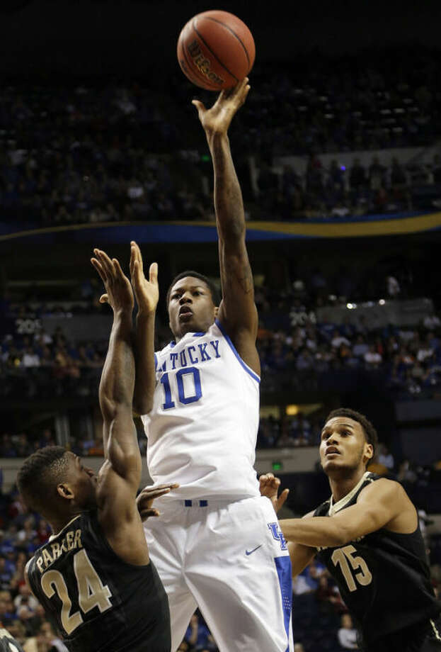 Kentucky guard Archie Goodwin (10) shoots over Vanderbilt's Dai-Jon Parker (24) and Kevin Bright (15) during the first half of an NCAA college basketball game at the Southeastern Conference tournament, Friday, March 15, 2013, in Nashville, Tenn. (AP Photo/Dave Martin)