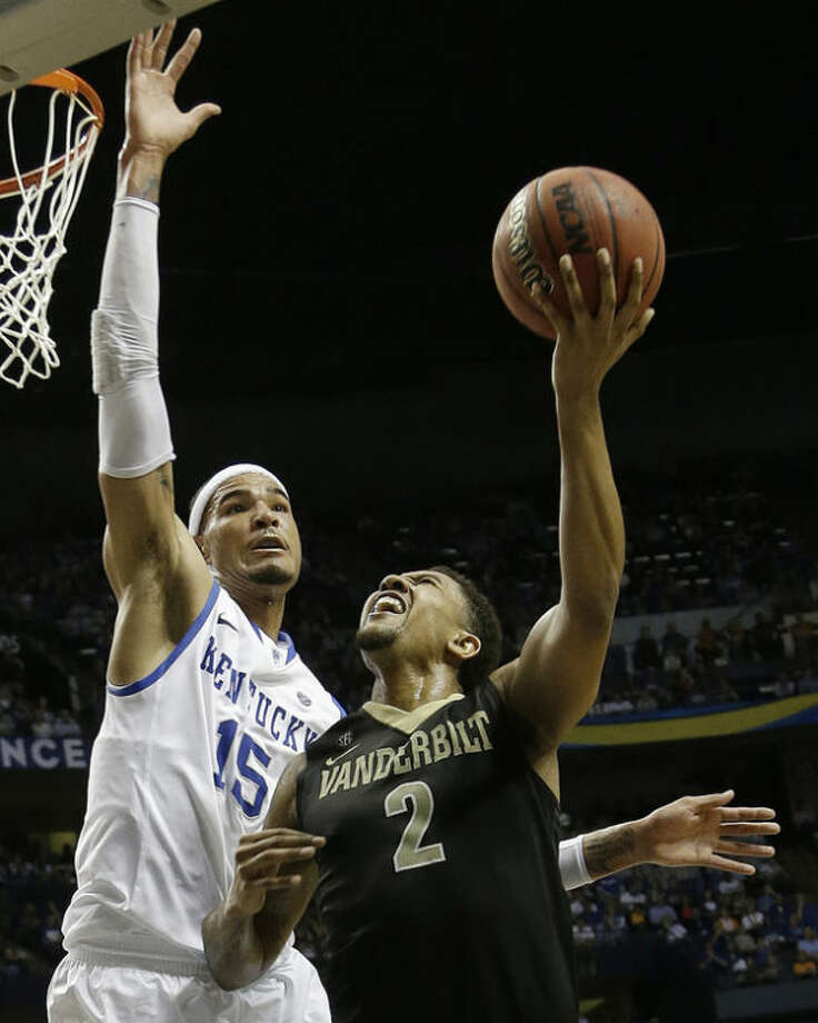 Vanderbilt guard Kedren Johnson (2) shoots against Kentucky forward Willie Cauley-Stein (15) during the second half of an NCAA college basketball game at the Southeastern Conference tournament, Friday, March 15, 2013, in Nashville, Tenn. (AP Photo/Dave Martin)