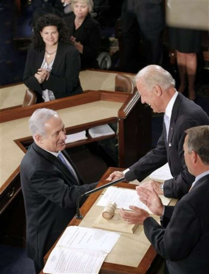 Israel''s Prime Minister Benjamin Netanyahu shakes hands with Vice President Joe Biden on Capitol Hill in Washington, Tuesday, May 24, 2011, prior to addressing a joint meeting Congress. House Speaker John Boehner of Ohio is at right. (AP Photo/J. Scott Applewhite)