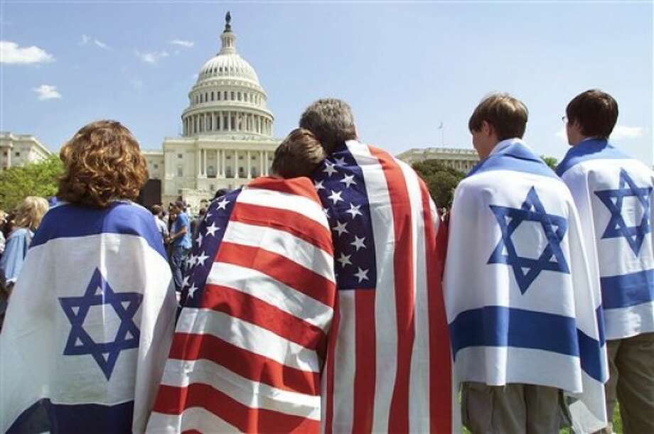 FILE - In this April 15, 2002, file photo flag-draped members of the Ornstein family, who live both in New York and Israel, join thousands of supporters of Israel at a rally at the Capitol in Washington. In a Sunday morning May 22, 2011, speech to the American Israel Public Affairs Committee (AIPAC), the President Barack Obama is expected to focus on the deep U.S.-Israeli friendship and alliance after a contentious couple of days this week when he clashed publicly with Israeli Prime Minister Benjamin Netanyahu over ideas for a permanent Palestinian state. (AP Photo/J. Scott Applewhite/file)