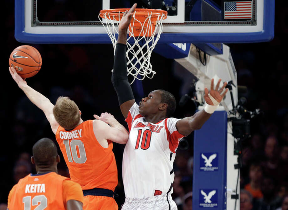 Syracuse's Trevor Cooney (10) drives past Louisville's Gorgui Dieng (10) during the first half of an NCAA college basketball championship game at the Big East Conference tournament Saturday, March 16, 2013, in New York. (AP Photo/Frank Franklin II) / AP
