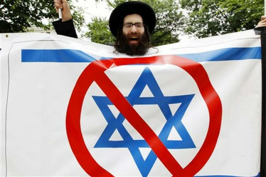 A pro-Palestinian Jewish demonstrator protests outside of the Washington Convention Center in Washington, where the American Israel Public Affairs Committee (AIPAC) is having its annual meeting Sunday, May 22, 2011. (AP Photo/Jose Luis Magana)