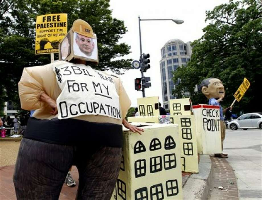 Pro-Palestinian demonstrators protest outside of the Washington Convention Center in Washington, where the American Israel Public Affairs Committee (AIPAC) is having its annual meeting Sunday, May 22, 2011. (AP Photo/Jose Luis Magana)