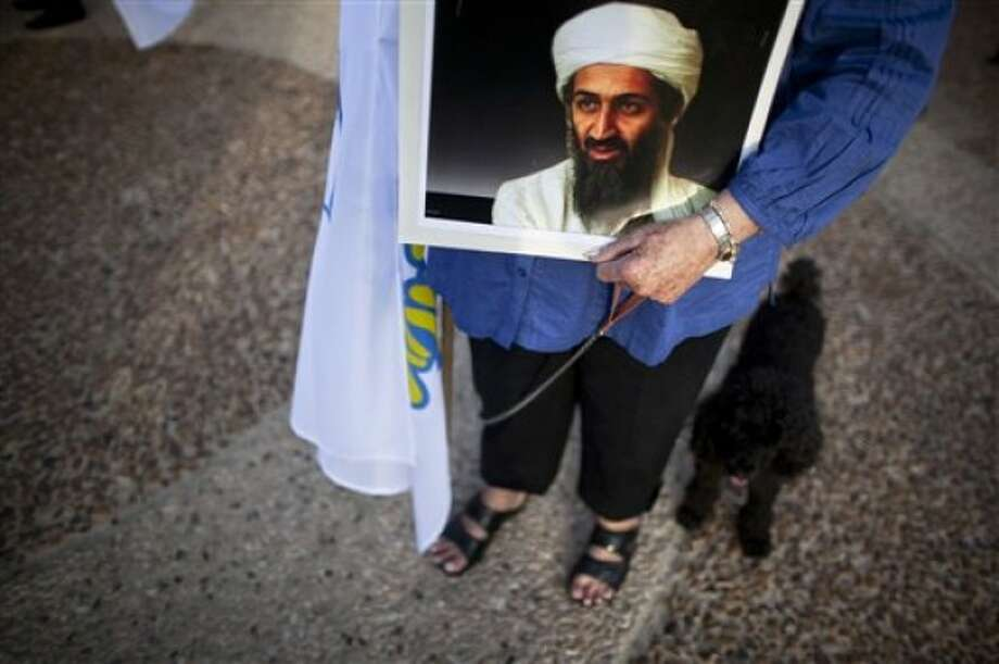 An Israeli right wing activist holds a picture of Osama bin Laden as she protests outside the US embassy in Tel Aviv, Israel, Sunday, May 22, 2011. US President Barack Obama warned America''s pro-Israel lobby on Sunday that the Jewish state will face growing isolation without a credible Middle East peace process. He defended his endorsement of a future Palestine based on Israel''s 1967 boundaries but subject to negotiated land swaps as a public expression of long-standing U.S. policy. (AP Photo/Oded Balilty)