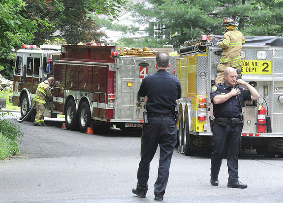 Fire and police respond Monday to a home on Pond Road in Wilton where an incident with chemicals needed to be contained. hour photo/Matthew Vinci