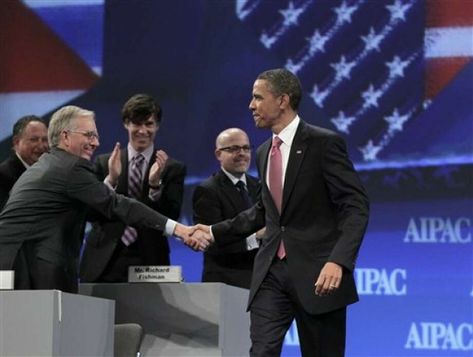 President Barack Obama is welcomed by delegates as he arrives to speak at the American Israel Public Affairs Committee (AIPAC) convention in Washington, Sunday, May 22, 2011. (AP Photo/J. Scott Applewhite)