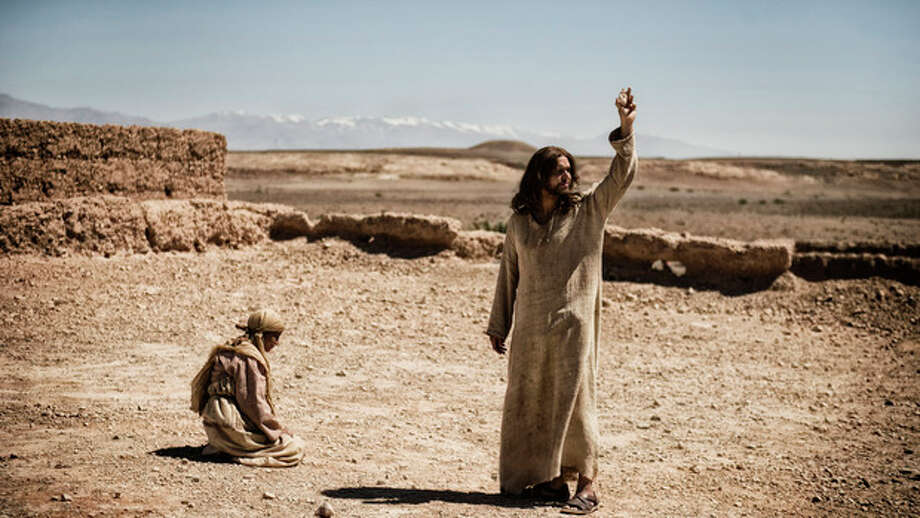 """This publicity image released by History shows Diogo Morcaldo as Jesus, right, in a scene from """"The Bible,"""" on History. The producers of the cable TV miniseries on the Bible say Internet chatter that their Satan character resembles President Barack Obama is """"utter nonsense."""" Mark Burnett and Roma Burnett said Monday the Moroccan actor who played Satan in the History channel series has played Satanic characters in other Biblical programs long before Obama was elected president. (AP Photo/History, Joe Alblas) / History"""