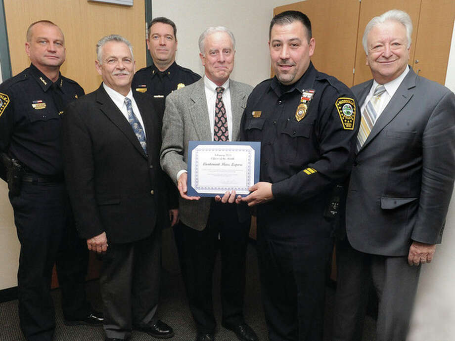 Hour photo / Matthew VinciFrom left, Police Chief Thomas E. Kulhawik, Commissioner Peter K. Torrano, Deputy Police Chief David P. Wrinn, Commissioner Daniel F. O'Connor, Officer of the Month Lt. Marc Lepore and Norwalk Mayor Richard Moccia. -- See story, Page A5