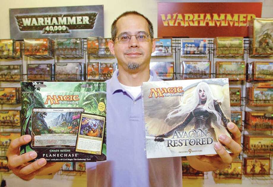 Hour photo / Erik TrautmannSteven Bryant, owner of the new gaming store, Battleground Gaming. / (C)2012, The Hour Newspapers, all rights reserved